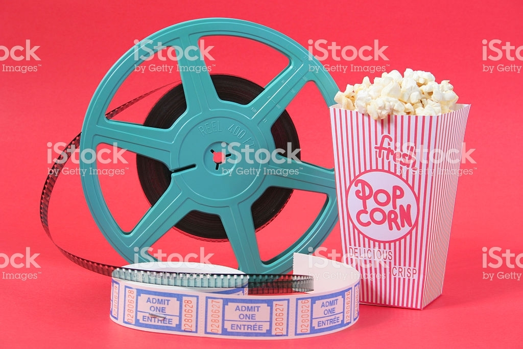 Film reel, popcorn and movie tickets on red background.